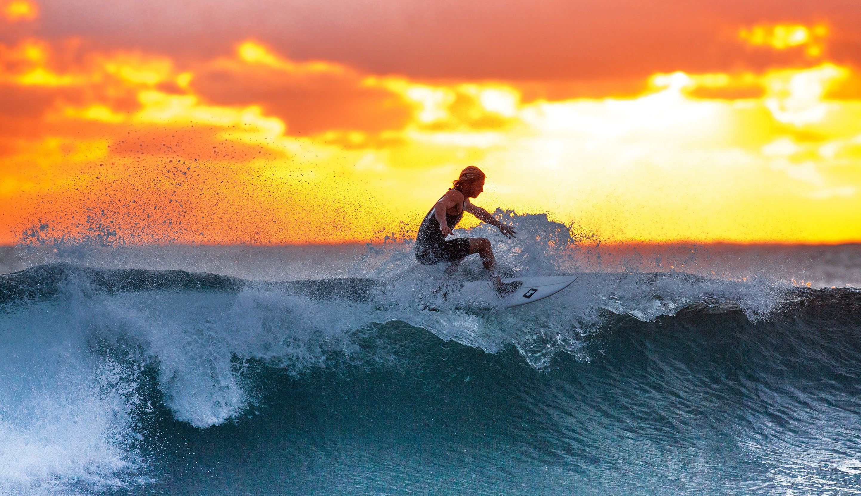 Surfers find solace in their daily dose of vitamin sea amidst vastly polluted waters
